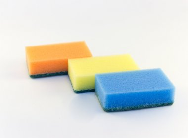 Three sponges for washing dishes on white background