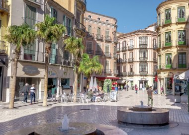 MALAGA - JUNE 12: City street view with cafeteria terraces and s