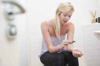 Teenage Girl Self Harming With Knife Blade