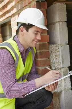 Architect Checking Insulation During Construction Project stock vector