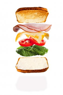 Putting Together a Cheese and Ham Sandwich