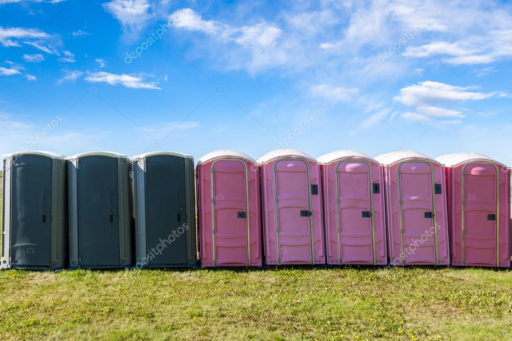Outdoor Portable Toilets on an Open Field