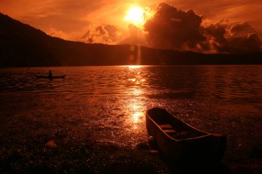 Fishing boat on sunset on Batur lake