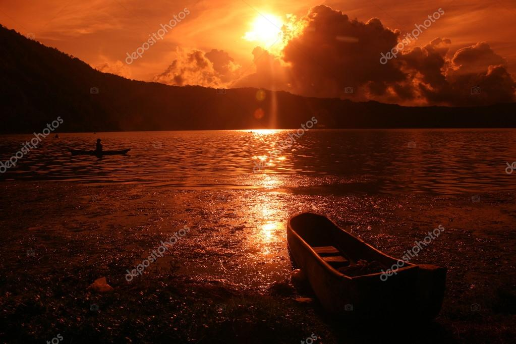 Fishing boat on sunset on Batur lake
