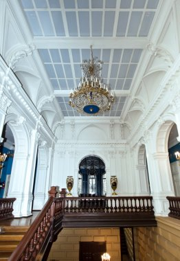 Grand hall in old majestic palace with oak staircase