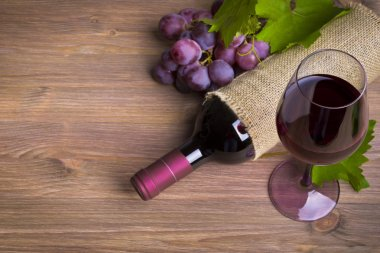 Bottle of wine, red grape and glass