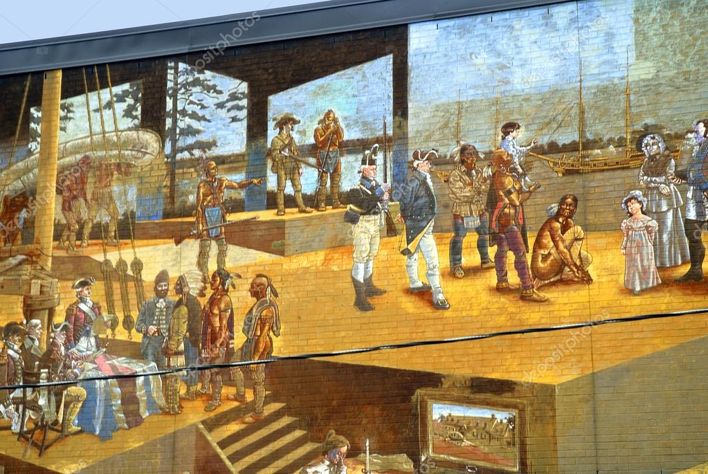 Huge Wall Paintings in the Distillery District of Toronto in Canada depicting the city's story