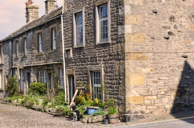 The village of Grassington in the Yorkshire Dales and Linton Falls