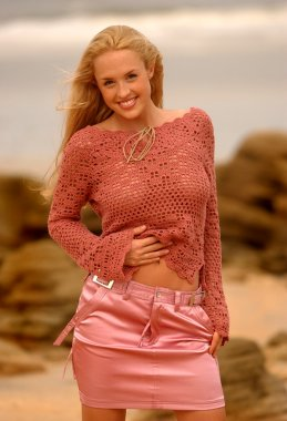 Pink Sheer Top - Pink Shiny Skirt - Ocean Rock and Beach Background - Big Smile