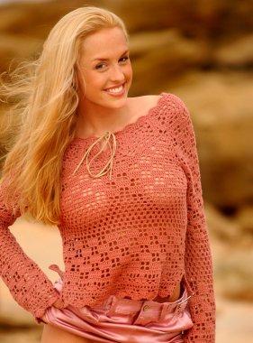 Lauren Thompson Pink Sheer Top - Pink Shiny Skirt - Ocean Rock and Beach Background - Big Smile