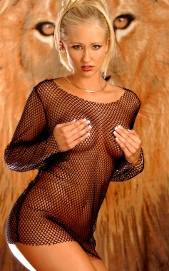 Blond Bombshell Channel - Lion's Eyes Background - oh ya...and brown top no panties