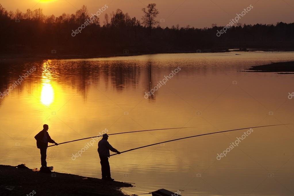 Two men fishing on river