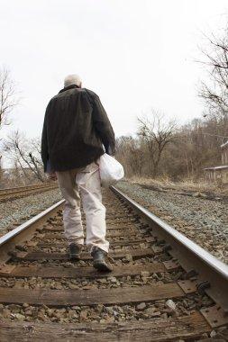 Homeless Man on Railroad Tracks