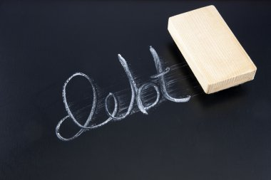 The word DEBT written in chalk on a chalkboard being rubbed out by an eraser stock vector