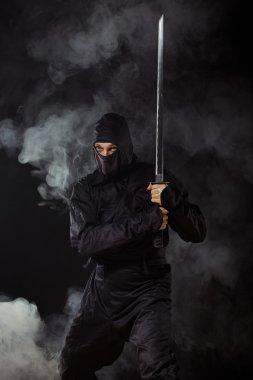 Ninja with sword in smoke