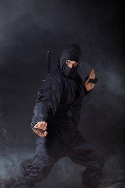 Ninja on black in smoke