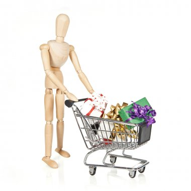 Wooden character with shopping cart and Christmas gifts