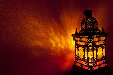 Moroccan lantern with gold colored glass in horizontal position