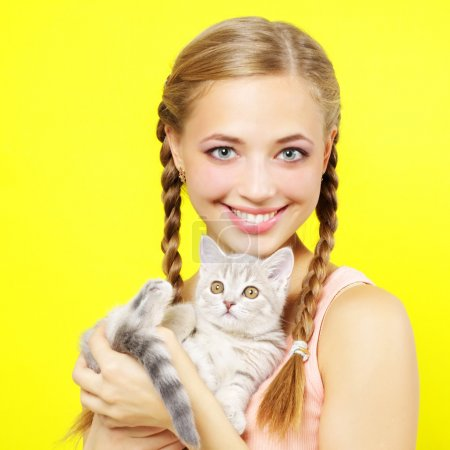Smiling girl with Scottish kitten