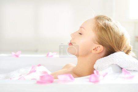 girl relaxing in bathtub