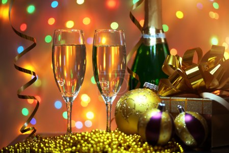 Photo for Glasses of champagne with gift box. background of lights - Royalty Free Image