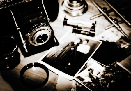 Photo for Vintage still life with retro photo camera and old photos - Royalty Free Image