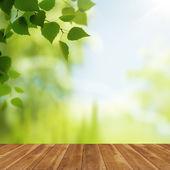 Wooden desk over natural backgrounds