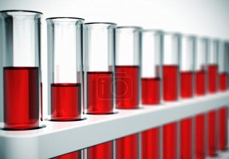 Photo pour Verre laboratoire chimique tubes à essai rouge liquide ou de sang. effet de la mise au point sélective - image libre de droit