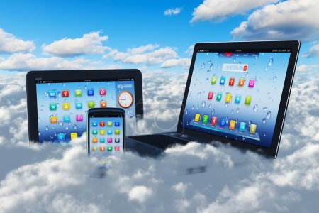 Photo pour Creative cloud computing concept: modern laptop notebook, tablet computer PC and black glossy touchscreen smartphone in the blue sky with clouds - image libre de droit