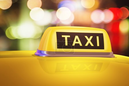 Yellow taxi sign on car