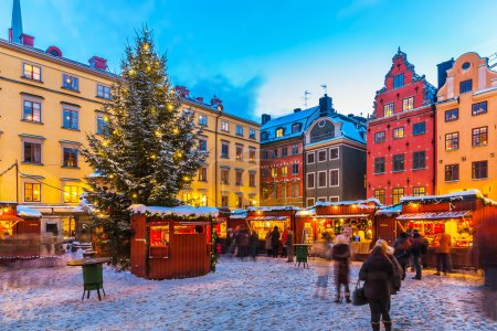 Photo for Beautiful snowy winter scenery of Christmas holiday fair at the Big Square (Stortorget) in the Old Town (Gamla Stan) in Stockholm, Sweden - Royalty Free Image
