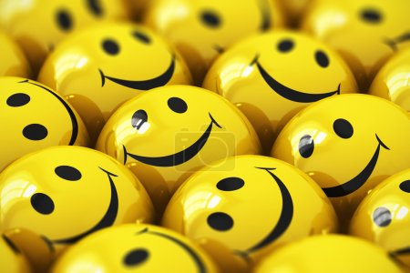 Photo for Macro view of happy yellow smiley face ball icons or buttons with selective focus effect - Royalty Free Image
