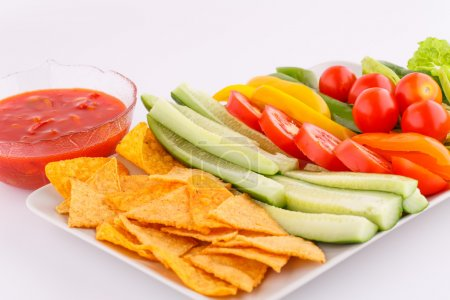 Nachos, vegetables and red sauce