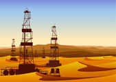 Landscape with oil rigs in barren desert with sand dunes