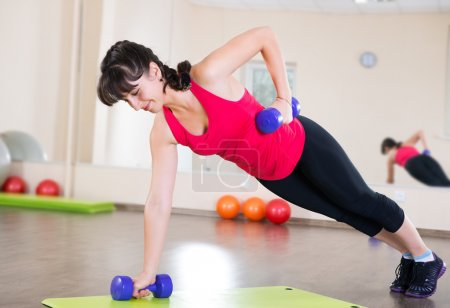 Photo for Pretty young girl fitness workout in gym - Royalty Free Image