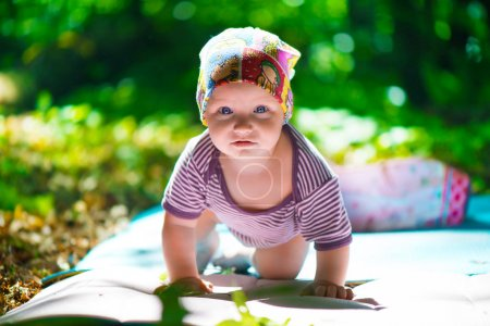 Cute baby crawling in grass