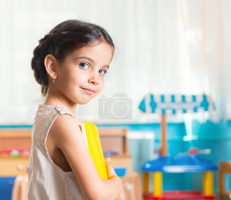 Photo for Beautiful little latin girl portrait in daycare - Royalty Free Image