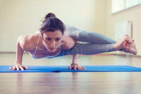 Beautiful young woman yoga workout