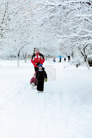 Father with children walking in winter