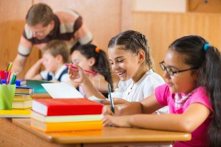 Portrait of happy pupil at lesson