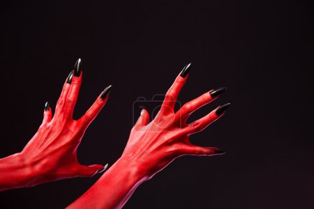 Spooky red devil hands with