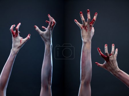 Photo for Creepy set of bloody zombie hands, studio shot over gray background - Royalty Free Image