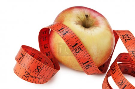 measure tape and apple isolated