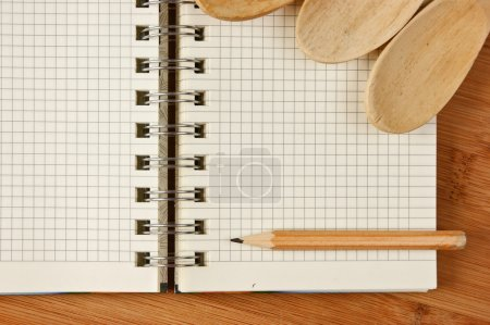 notebook for culinary recipes on a kitchen cutting board