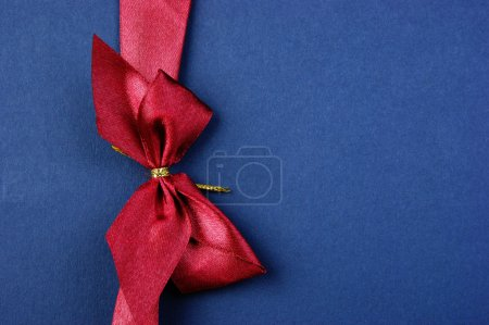 Blue Christmas gift box with red bow and ribbon