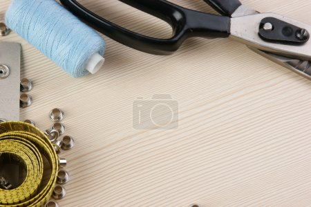 Photo for Frame sewing supplies on the table - Royalty Free Image