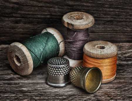 Photo for Still life of spools of thread on a wooden background - Royalty Free Image
