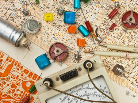 Photo for Old electronic components lie on the wiring diagram - Royalty Free Image