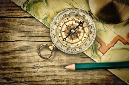 Photo for Old map and compass on a wooden table - Royalty Free Image