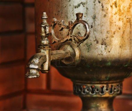 Old brass samovar on a kitchen